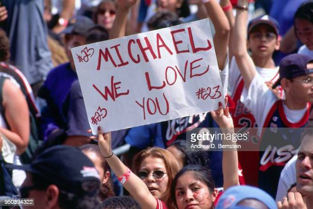 A fan holds up a sign during the 1998 Chicago Bulls Celebration Rally on June 16 1998 at Grant Park in Chicago Illinois NOTE TO USER User expressly...