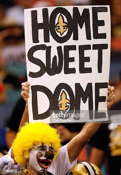 A fan holds up a sign during the Monday Night Football game against the Atlanta Falcons on September 25 2006 at the Superdome in New Orleans...