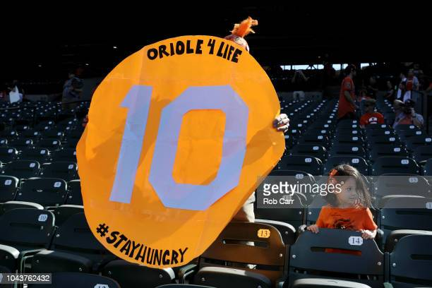 A fan holds up a sign for Adam Jones of the Baltimore Orioles before the start of the Orioles and Houston Astros game at Oriole Park at Camden Yards...