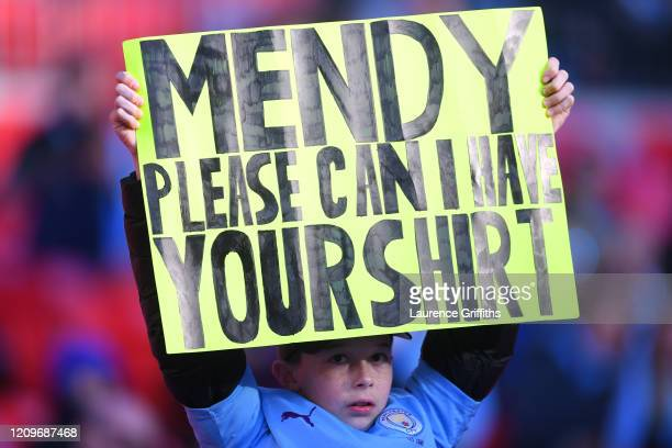 A fan holds up a sign for Benjamin Mendy of Manchester City prior to the Carabao Cup Final between Aston Villa and Manchester City at Wembley Stadium...
