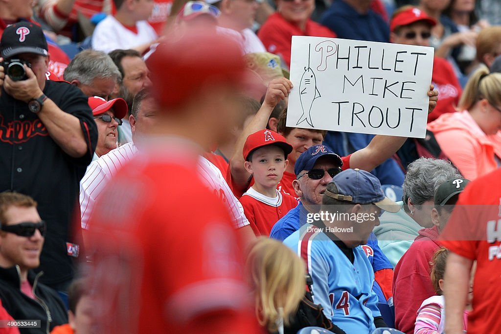 A fan holds up a sign for Mike Trout #27 of the Los Angeles Angels of Anaheim as he waits on deck in the first inning against the Philadelphia Phillies at Citizens Bank Park on May 14, 2014 in Philadelphia, Pennsylvania.