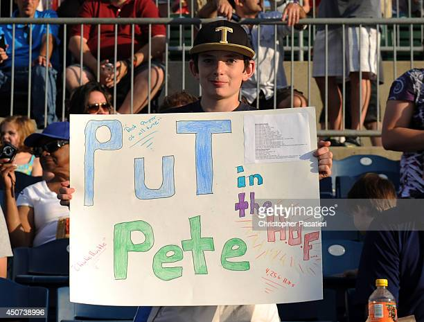 A fan holds up a sign in support of former Major League Baseball player Pete Rose prior to his managing the game for the Bridgeport Bluefish against...