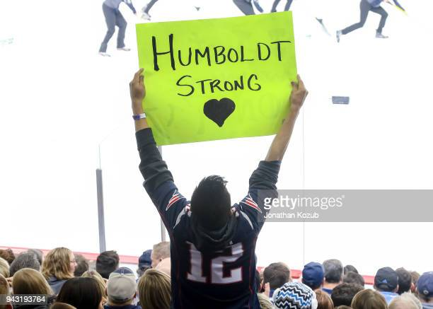 A fan holds up a sign in support of the Humboldt Broncos during third period action between the Winnipeg Jets and the Chicago Blackhawks at the Bell...