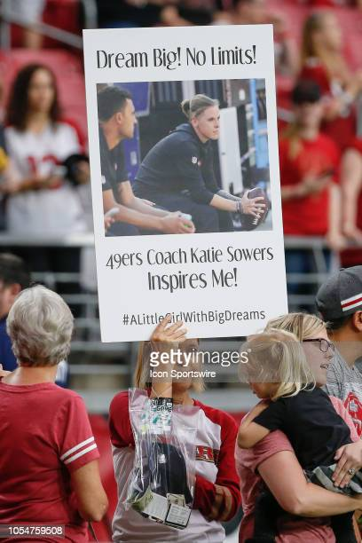 A fan holds up a sign praising 49ers coach Katie Sowers before the NFL football game between the San Francisco 49ers and the Arizona Cardinals on...