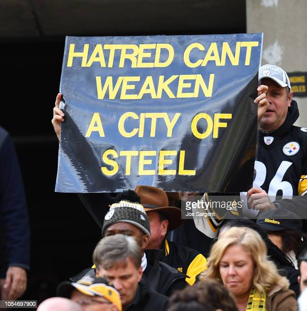 A fan holds up a sign to honor the victims of the shooting at the Tree of Life Synagogue during the game between the Pittsburgh Steelers and the...