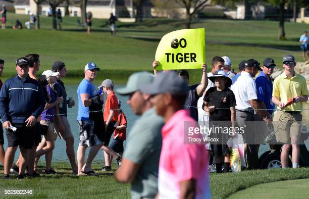 A fan holds up a sing as Tiger Woods walks by during the second round of the Arnold Palmer Invitational presented by MasterCard at Bay Hill Club and...