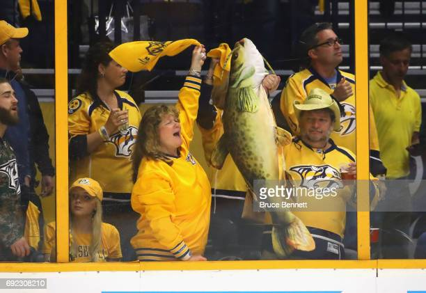 A fan holds up a stuffed catfish prior to Game Three of the 2017 NHL Stanley Cup Final at the Bridgestone Arena on June 3 2017 in Nashville Tennessee...
