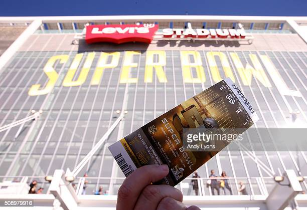 A fan holds up a ticket to Super Bowl 50 outside Levi's Stadium on February 7 2016 in Santa Clara California