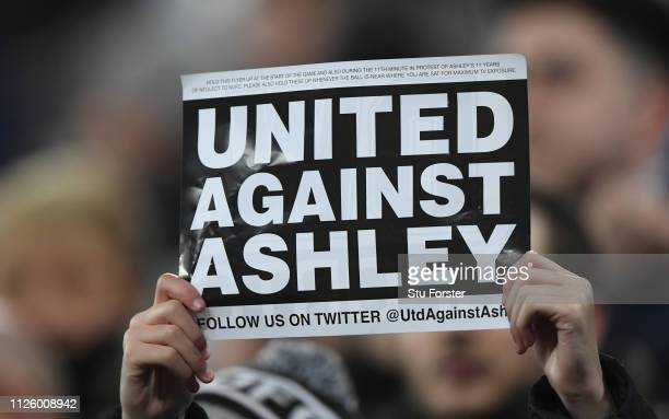 A fan holds up a 'United Against Ashley' card during the Premier League match between Newcastle United and Manchester City at St James Park on...