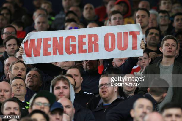 A fan holds up an antiArsene Wenger sign during the English Premier League football match between West Bromwich Albion and Arsenal at The Hawthorns...