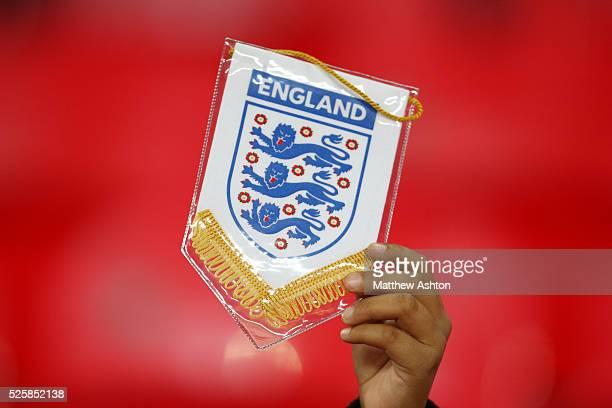 A fan holds up an England pennent