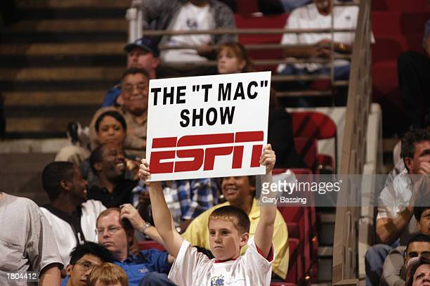A fan holds up an ESPN sign during the game between the San Antonio Spurs and the Orlando Magic during the game at TD Waterhouse Centre on January 31...