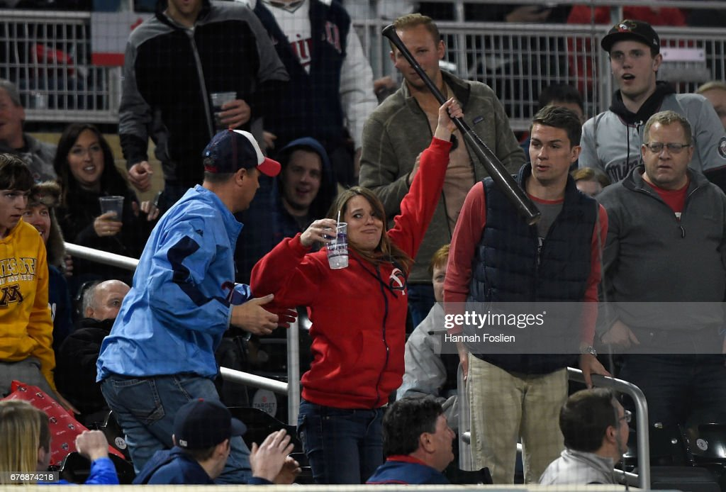 A fan holds up the bat of Byron Buxton of the Minnesota Twins after it flew into the stands during an at-bat in the eighth inning of the game against the Oakland Athletics on May 2, 2017 at Target Field in Minneapolis, Minnesota. The Twins defeated the Athletics 9-1.