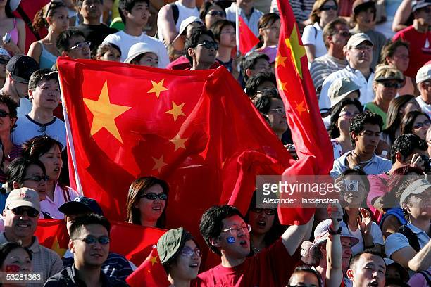 A fan holds up the Chinese flag after Li Ting and Guo Jingling of China won the gold medal the women's 3 meter Synchro Springboard final during the...