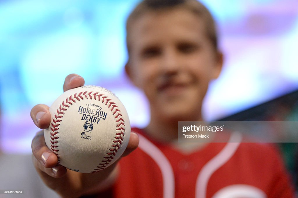 A fan holds up the home run ball that he caught during the Gillette Home Run Derby presented by Head & Shoulders at Great American Ball Park in Cincinnati on Monday, July 13, 2015 in Cincinnati, Ohio.