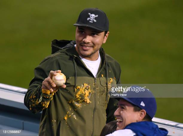 Fan holds up the homerun ball of Justin Turner of the Los Angeles Dodgers which landed in his nachos during the third inning against the Colorado...