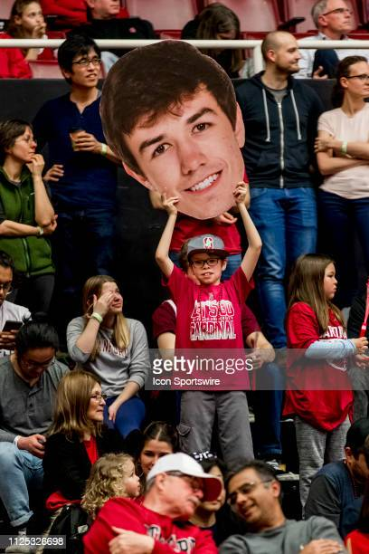 A fan holds up the outsized face of Stanford Cardinal guard Cormac Ryan during the men's college basketball game between the USC Trojans and Stanford...