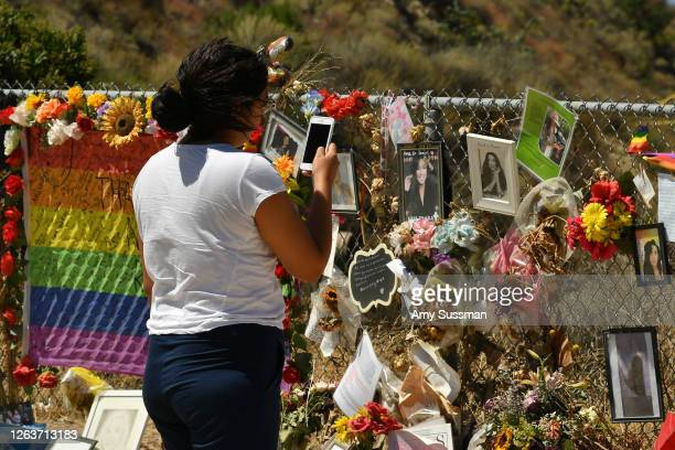 A fan honors actress Naya Rivera at a memorial at Lake Piru where Rivera's death was ruled an accidental drowning on August 3 2020 in Piru California...