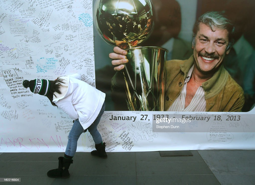 A fan in a Celtics cap adds her wishes to a wall near Staples Center in honor of the late Dr. Jerry Buss, owner of the Los Angeles Lakers, before the game against the Boston Celtics on February 20, 2013 in Los Angeles, California.