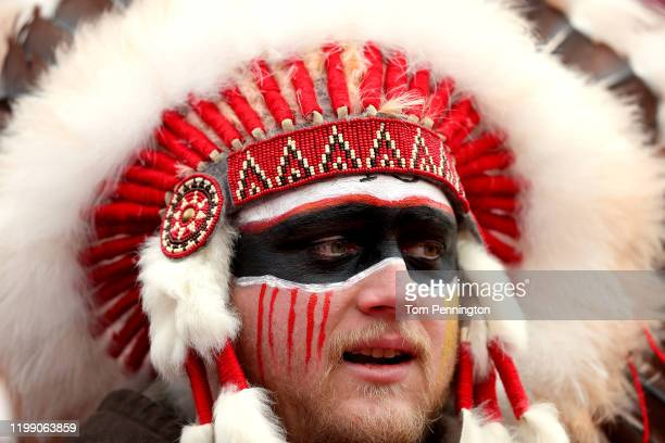 Fan in a headdress looks on prior to the AFC Divisional playoff game between the Kansas City Chiefs and the Houston Texans at Arrowhead Stadium on...