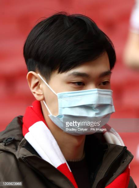 A fan in a mask during the Premier League match at the Emirates Stadium London