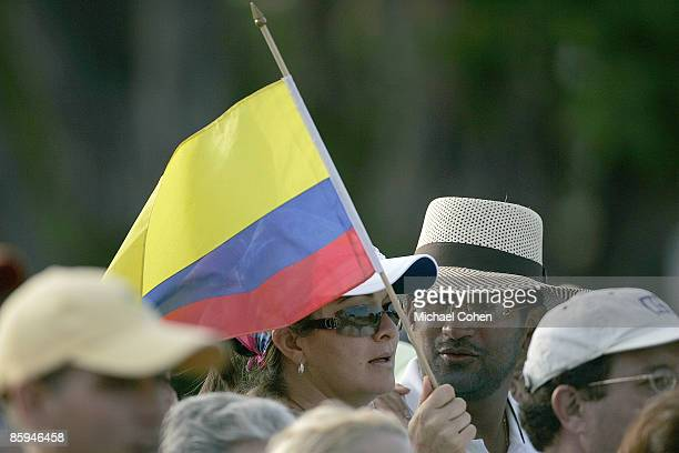 A fan in Camilo Villegas' gallery waves a Columbian flag in action during the third round of the Ford Championship at Doral Golf Resort and Spa in...