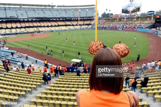 A fan in Mickey Mouse ears watches batting practice prior to Game 6 of the 2017 World Series between the Houston Astros and the Los Angeles Dodgers...