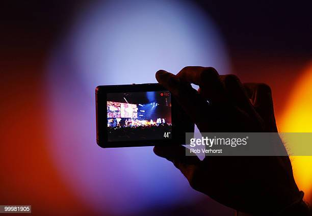 A fan in the audience records a Lady Gaga concert on a video camera phone at Gelredome on May 15 2010 in Arnhem Netherlands