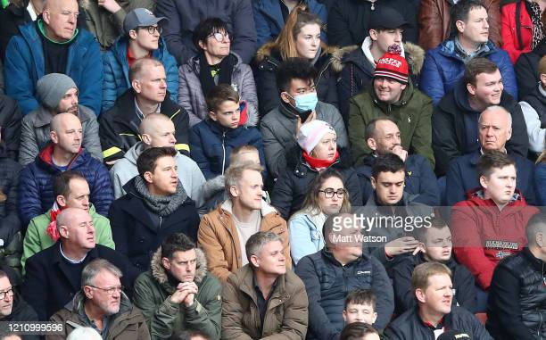 A fan in the crowd wearing a face mask during the Premier League match between Southampton FC and Newcastle United at St Mary's Stadium on March 07...