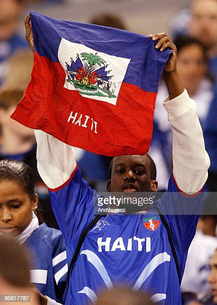 A fan in the stands holds up a Haitian flag and is wearing a Haiti jersey in the first quarter as the Indianapolis Colts take on the Baltimore Ravens...