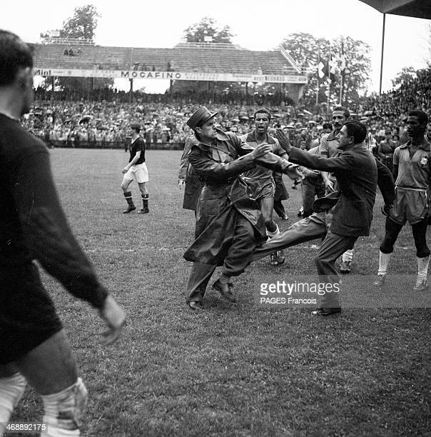 A fan invades the pitch during the World Cup football 1954 quarter final match between Brazil and Hungary at the Wankdorf Stadium on June 27 1954 in...