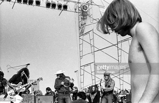 A fan is absorbed with The Jefferson Airplane at The Altamont Speedway on December 6 1969 in Livermore California