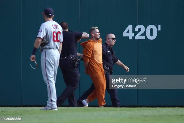 A fan is arrested after over the fence into the bullpen trying to avoid police after running on the field in the ninth inning during a game between...