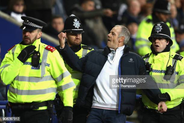 A fan is ejected from the crowd during the Premier League match between Leicester City and Watford at The King Power Stadium on January 20 2018 in...
