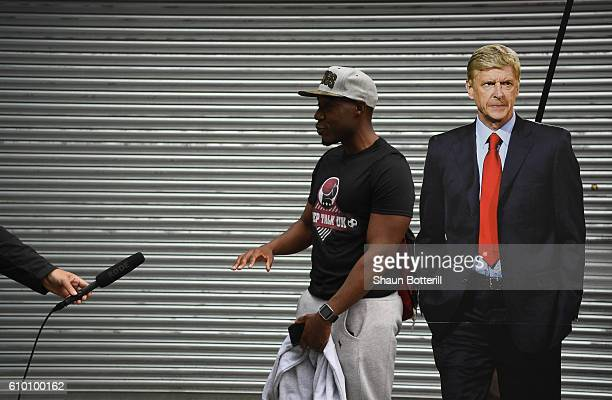 A fan is interviewed before the Premier League match between Arsenal and Chelsea at Emirates Stadium on September 24 2016 in London England