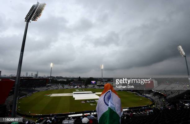 Fan is pictured awaiting the resumption in play during the Semi-Final match of the ICC Cricket World Cup 2019 between India and New Zealand at Old...