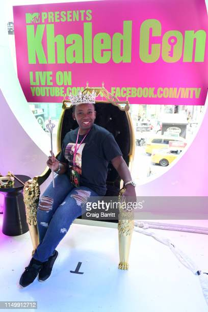 """Fan is poses in the photo booth as """"MTV Presents: Khaled Con,"""" a DJ Khaled-hosted fan event in MTV's Times Square Studio, celebrating the release of..."""