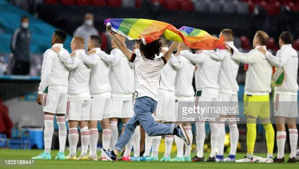 Fan is running on the field of play with a rainbow flag during the UEFA Euro 2020 Championship Group F match between Germany and Hungary at Allianz...