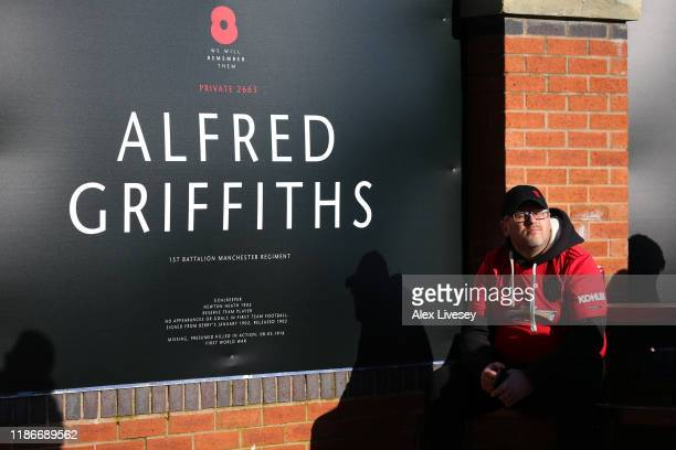 A fan is seen by a sign outside the stadium which is displayed in honour of Armisitice Day remembering former 1st Battalion Manchester Regiment...