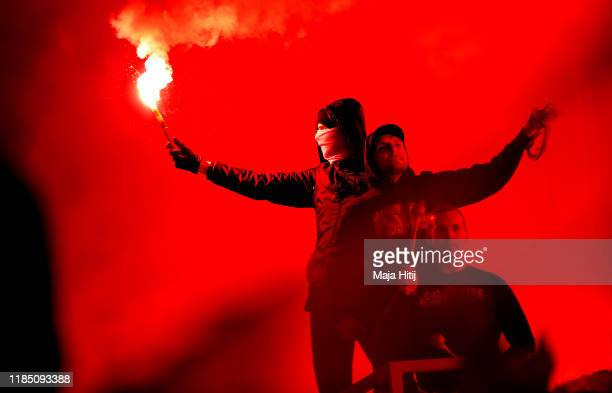 A fan is seen holding a flare inside the stadium during the Bundesliga match between 1 FC Union Berlin and Hertha BSC at Stadion An der Alten...