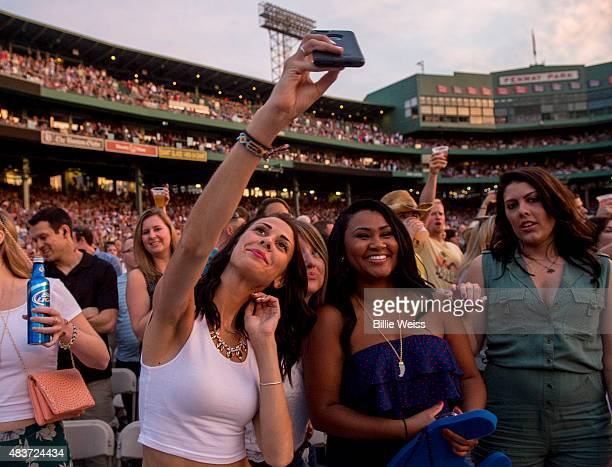 A fan is seen taking a selfie as the Zac Brown Band performs at Fenway Park during the Major League Baseball Ballpark Concert Series during the...
