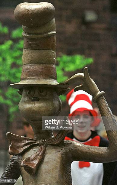 A fan is seen through the bronze Cat in the Hat statue at the Dr Suess Memorial Sculpture Garden May 31 2001 in Springfield MA The $62 million garden...