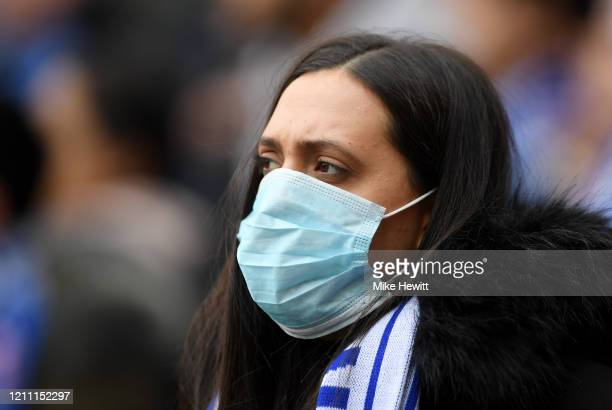 Fan is seen wearing a disposable face mask prior to the Premier League match between Chelsea FC and Everton FC at Stamford Bridge on March 08, 2020...