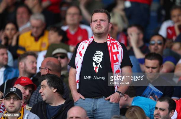 A fan is seen wearing a 'Merci Arsene' T shirt during the Premier League match between Huddersfield Town and Arsenal at John Smith's Stadium on May...
