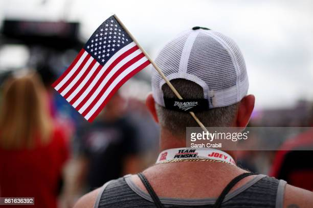 A fan is seen with an American flag before the Monster Energy NASCAR Cup Series Alabama 500 at Talladega Superspeedway on October 15 2017 in...