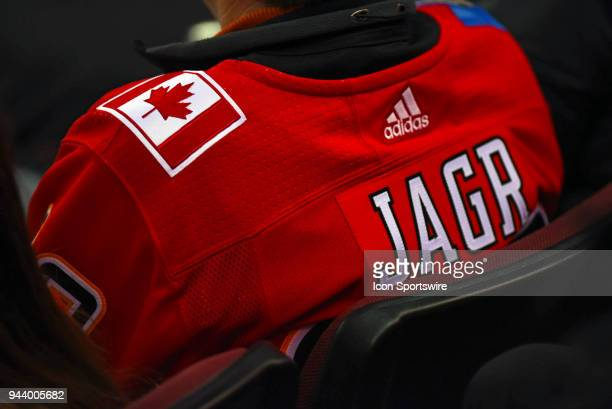 A fan is shown wearing a Calgary Flames Jaromir Jagr jersey during the second period of an NHL game where the Calgary Flames hosted the Las Vegas...