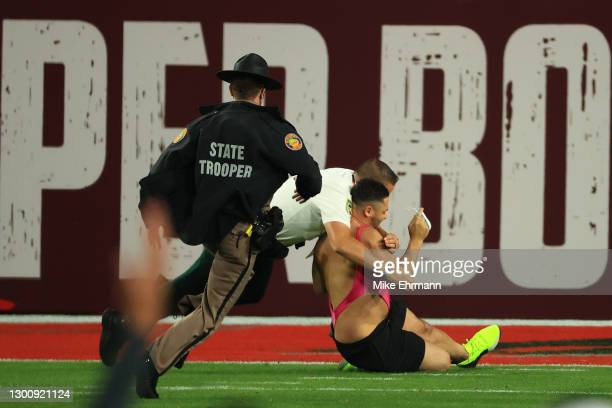 Fan is tackled by law enforcement after running on the field during the fourth quarter of Super Bowl LV between the Tampa Bay Buccaneers and the...