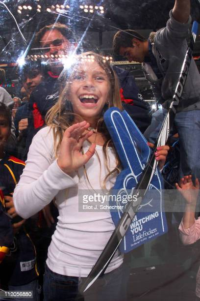 A fan is very happy to have a stick given to her by Stephen Weiss of the Florida Panthers after their final game of the season against the Washington...