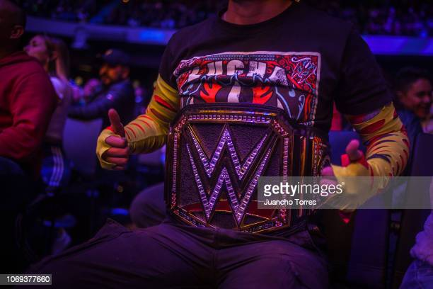 A fan is wears a championship belt during an AAA World Wide Wrestling match on November 16 2018 in Bogota Colombia