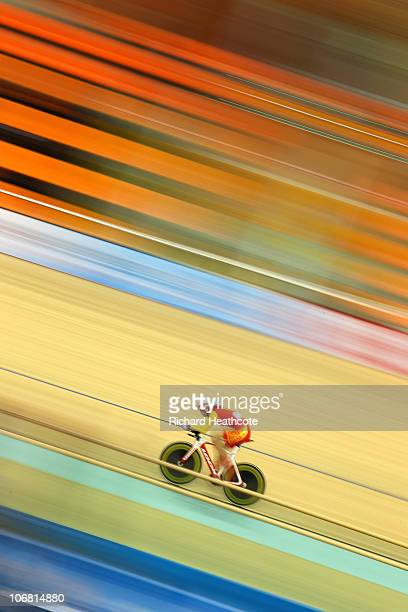 Fan Jiang of China sets an Asian Games record in the Women's Individual Pursuit Heat 4 at the Guangzhou Velodrome during day two of the 16th Asian...